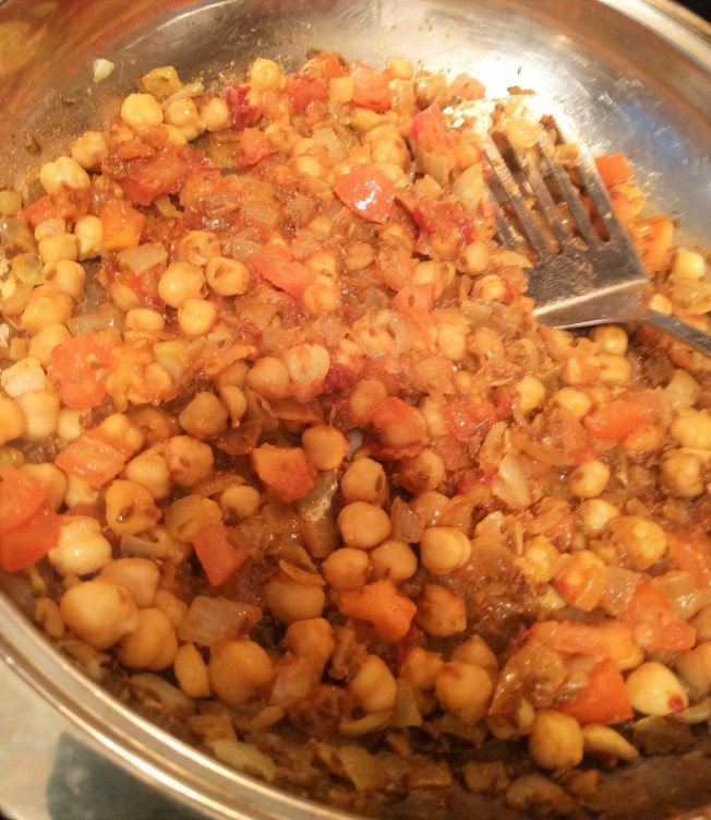 added chickpeas, tomatoes, tomato paste