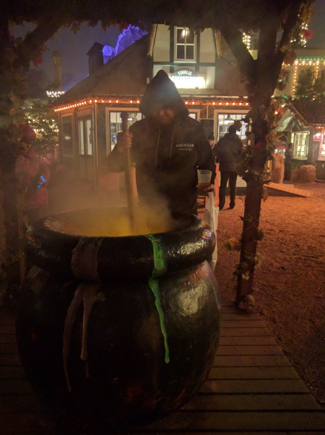 Hubby stirring cauldron